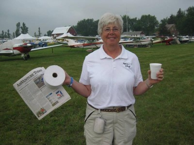 """Barb with the three """"necessities of KOSH"""". Coffee, the morning paper and a good roll of T.P. (Story behind this - has a happy ending - pun intended)"""