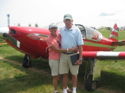 Paul offered to let people touch his polished airplane. The provision was they had to wear gloves that he provided.  Alan and Janet Dicker took the Custom Class C (151-235 H.P.) award.